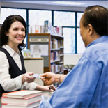Circulation assistant helping a patron