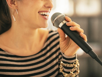 woman speaking to a mic
